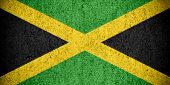 stock photo of jamaican flag  - flag of Jamaica or Jamaican banner on rough pattern texture - JPG