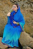picture of sari  - Beautiful girl in traditional Indian sari on temple background - JPG