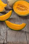 image of muskmelon  - Fresh melons on old wooden background - JPG