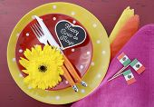 stock photo of tables  - Happy Cinco de Mayo bright colorful party table place setting with bright gerbera daisy flowers on distressed red wood table - JPG
