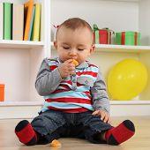 stock photo of mandarin orange  - Cute little baby child eating mandarin orange fruit - JPG