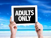 pic of adults only  - Tablet pc with text Adults Only with beach background - JPG