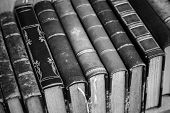 picture of book-shelf  - Old books with leather covers lay on the shelf vintage stylized monochrome photo - JPG
