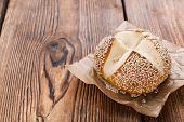 picture of sesame seed  - Pretzel Roll with Sesame seeds on rustic wooden background - JPG