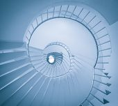 pic of spiral staircase  - View of spiral staircase from the ground looking up in monochrome color - JPG