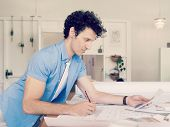 pic of draft  - Man working with drafts in office - JPG