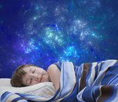 image of sleep  - Sleeping teen girl on blue abstract background - JPG