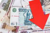 image of depreciation  - Red arrow on Russian money as depreciation of currency - JPG