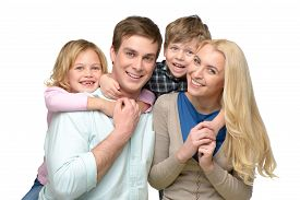 image of four  - Cheerful smiling family of four enjoying time together - JPG