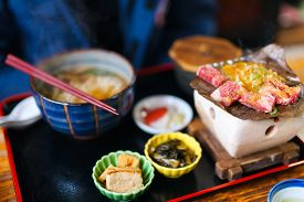 stock photo of japanese magnolia  - Traditional Japanese lunch with hida beef prepared on grill - JPG