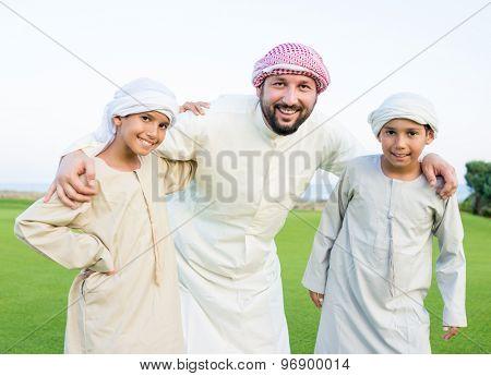Happy Arabic family on summer vacation