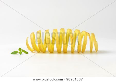 potato peel spiral on white background