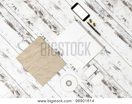 Set Of Identity Elements And Blank Magazine Mockup On Vintage Wooden Substrate