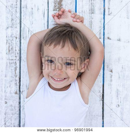 Child on white wooden background