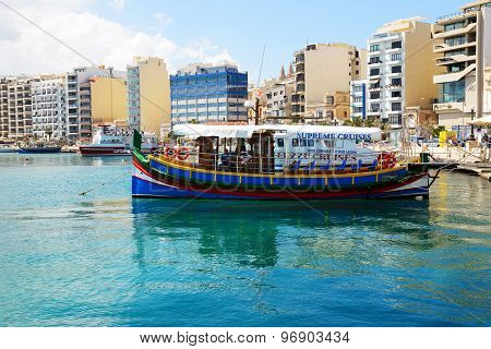 Sliema, Malta - April 22: The Traditional Maltese Luzzu Boat For Tourists Cruises On April 22, 2015