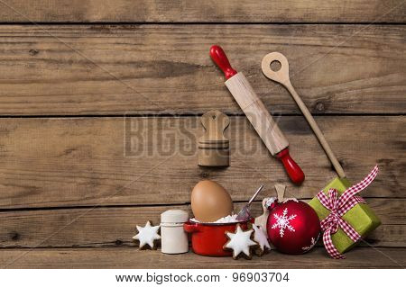 Baking in christmas time. Wooden background with kitchen utensils for cookies and cakes.