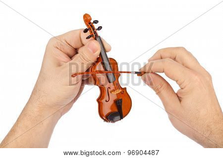 Hands and toy violin isolated on white background