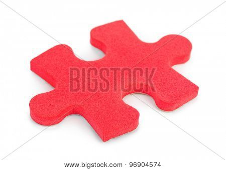 Piece of puzzle isolated on white background