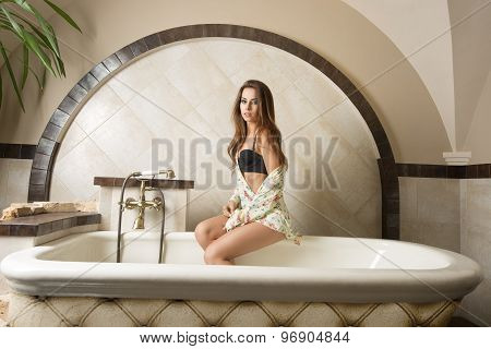 Sensual Girl Sitting In Bath Tub