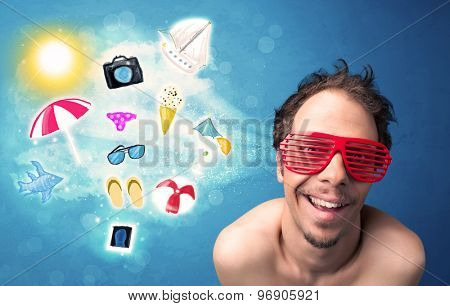 Happy joyful man with sunglasses looking at summer icons and symbols concept