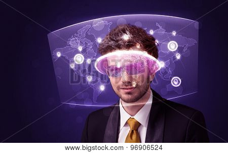 Young man looking at futuristic social network map concept