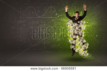 Cheerful businesman jumping with dollar banknotes around him on background