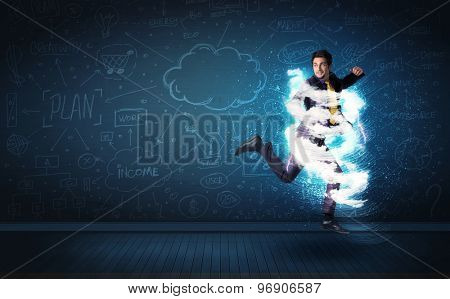 Happy business man jumping with storm cloud around him concept