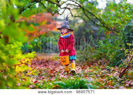 Little Girl In Witch Costume At Halloween