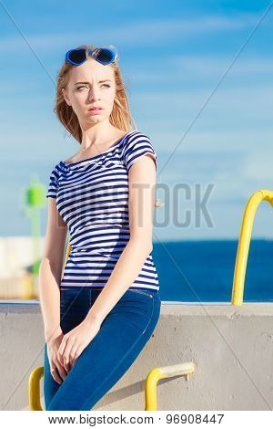 Woman Casual Style Against Stone Wall