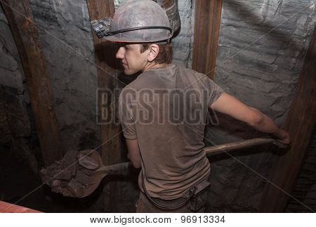 Donetsk, Ukraine - March 14, 2014: Miner Working A Shovel, Throwing Coal On The Conveyor. Mine Named