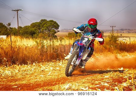 Hd - Motorbike Kicking Up Trail Of Dust On Sand Track During Rally Race.