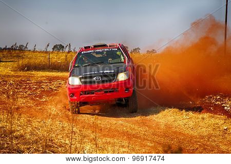 Hd Red Truck Kicking Up Dust On Turn Ar Rally