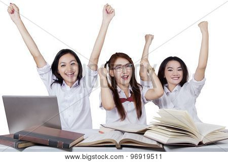 Attractive Teenage Students Expressing Success