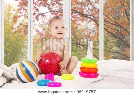Cute Baby On Bedroom At Home