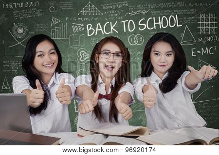 Excited Schoolgirls Showing Ok Sign