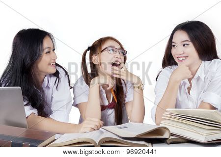 Group Of Beautiful Student Laughing While Studying