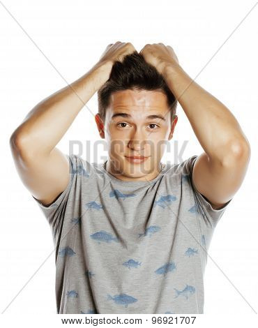 young pretty man isolated with hands on head little angry and confused