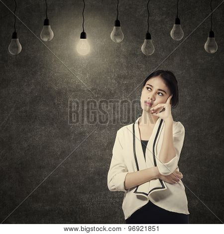 Pretty Woman Thinking Under Lightbulb