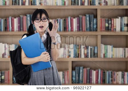 Shocked Female Student At Library