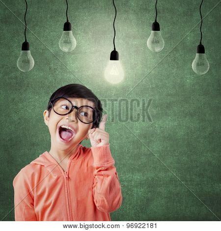 Smart Little Girl Pointing At Lamp