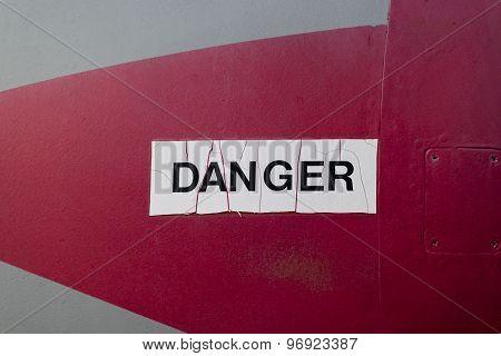 White Danger Sign On a Fighter Jet