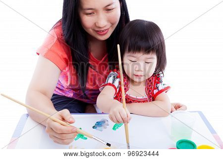 Mother With Child Girl Draw And Paint Together. Isolated On White