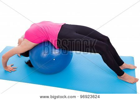 Woman Doing Yoga,  Lies On Gym Ball. Isolated On White. Studio Shot. Full Body