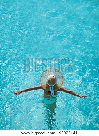 Caucasian model playing into clear water on summer vacation