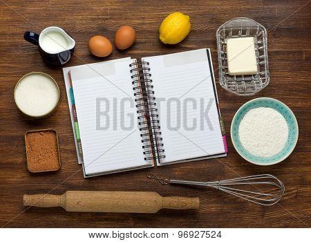 Baking cake in rural kitchen - dough recipe ingredients: eggs, flour, milk, butter, sugar on vintage