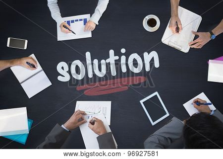 The word solution and business meeting against blackboard