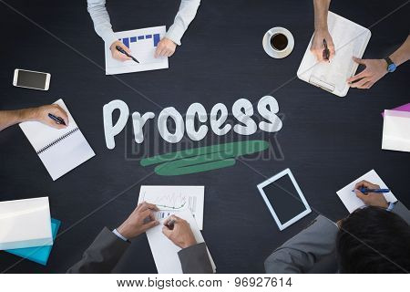 The word process and business meeting against blackboard