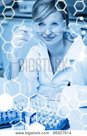 Science graphic against selfassured female scientist holding samples