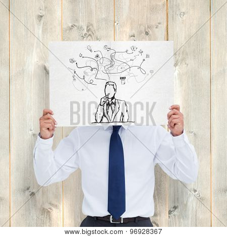 Tradesman holding blank sign in front of his head against pale wooden planks