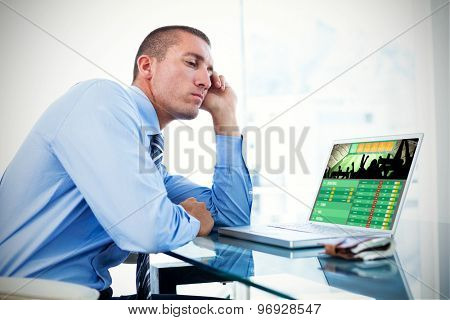 Tired businessman looking at his laptop against gambling app screen